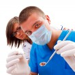 Stock Photo: A young doctor and his assistant looking to the patient - the patient's point of view