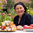Elderly woman with fresh food — Stock Photo