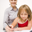 Little girl learning to write — Stock Photo