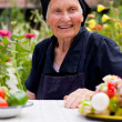Elderly woman at the table — Stock Photo