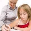 Stock Photo: Little girl learning to write