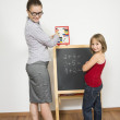 A happy teacher helping her student to calculate. — Stock Photo #14033842