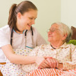 Helping a sick elderly woman — Stock Photo