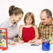 Stock Photo: Happy family learning