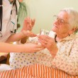 Medications for an old woman — Stock Photo #14036035