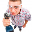 Stock Photo: Young handyman drilling