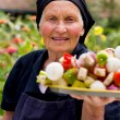Stock Photo: Elderly womwith fresh food