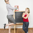 A happy teacher helping her student to calculate. — Stock Photo #14037020