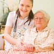 Helping a sick elderly woman — Stock Photo #14037139