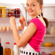 A young woman using the refrigerator — Foto Stock