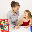 Stock Photo: Happy teacher and little girl