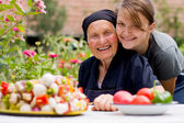 Visiting an elderly woman — Stock Photo