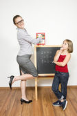 A happy teacher helping her student to calculate. — Stockfoto