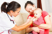 Pediatrician checking a baby — Stock Photo