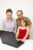 Family and laptop — Stock Photo