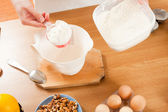 Dosing flour — Stock Photo