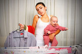 Tired mother with crying baby at home — Stock Photo