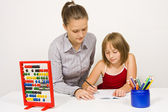 Teacher helping little girl — Stock Photo