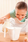 Young cook with milk — Stock Photo