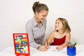Happy teacher and little girl — Stock Photo