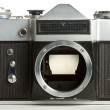 Old camera with removed lens — Stock Photo