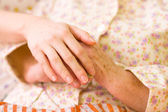 Caring hands - helping the needy — Stock Photo
