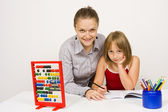 Happy teacher and student in school — Stock Photo