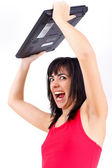 Agitated woman with laptop — Stock Photo