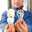 Lets save some money with economic bulb — Stock Photo