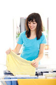 Smiling young housewife — Stock Photo
