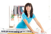 Happy housewife with laundry — Stock Photo