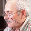Elderly man concetrating — Stock Photo