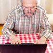 Royalty-Free Stock Photo: Old man using technology