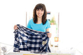 Woman drying clothes — Stock Photo