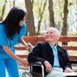 Kind Doctor Chatting With Elderly Lady — Stock Photo #24849211