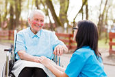Doctor, Nurse Talking With Kind Lady — Foto Stock