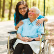 Woman in Wheelchair and a Nurse — Foto Stock