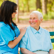 Royalty-Free Stock Photo: Caring Nurse with Kind Lady