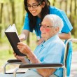 Nurse and Patient Reading — Stockfoto