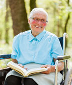 Lady in Wheelchair Reading Bible — Stock Photo