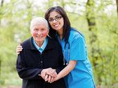 Helping Elderly Peoplee — Stock Photo