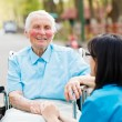 Nurse Consoling Senior Patient — Stockfoto