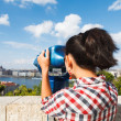 Tourist looking at cityscape - Stock Photo