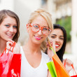 Stock Photo: Three Women Out In Town Shopping