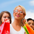 Girl With Her Friends After Shopping — Stock Photo #27280587
