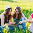 Girls With Thier Tablet Outdoors — Stock Photo