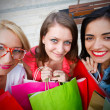 Smiling Girls Holding Shopping Bags — Stock Photo #28355327