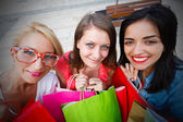 Smiling Girls Holding Shopping Bags — Stock Photo