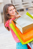 Kind Lady With Shopping Bags — Stock Photo