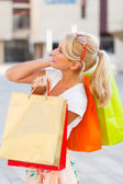 Many Shoping Bags Held by Girl — Stock Photo